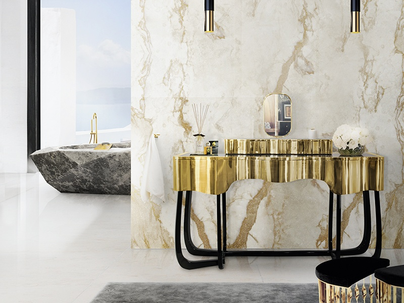 Maison Valentina crafts its decadent designs from rich materials, such as mahogany, high-gloss lacquer, and polished brass. Seen here are the Diamond bath, Sinuous dressing table, and Mandy stool, the latter inspired by a cuff bracelet.
