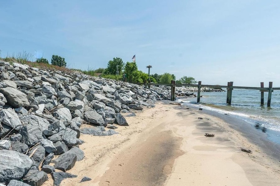 A secluded beach and deep-water dock make this Chesapeake Bay waterfront home an ideal escape from the city.