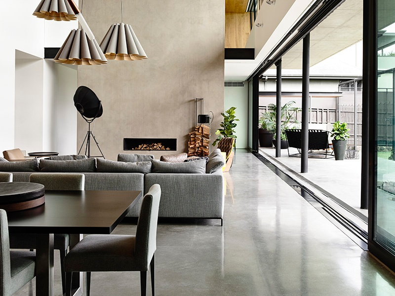 In Concrete House in Melbourne, Australia, by Matt Gibson Architecture, carefully curated furniture and lighting set off the sheen of polished concrete floors and kitchen surfaces. It's the material at its most elegant, and illustrates the primary way concrete is slotting into luxury residential design. Photograph: Derek Swalwell
