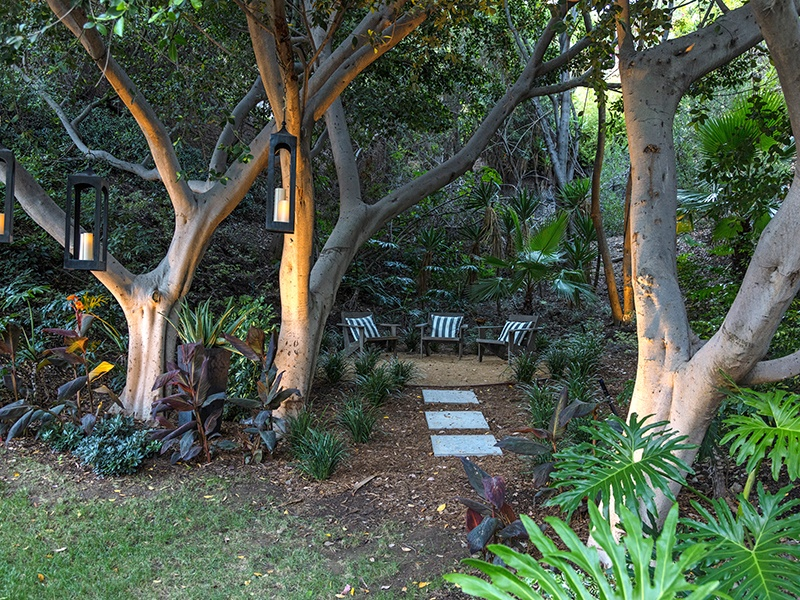 This seven-bedroom residence in Beverly Hills, California, has a wonderful quiet space between lawn and trees—ideal for a restful meditation spot.