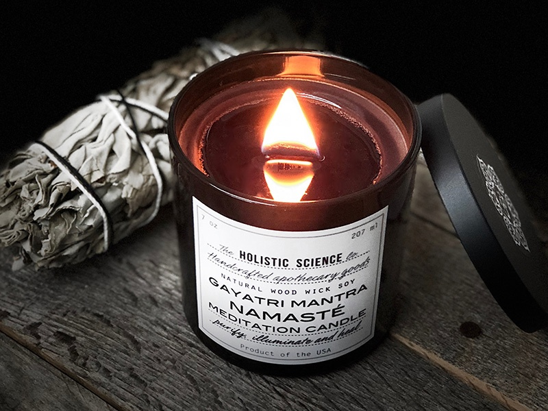 Staring at the flame of a candle, such as The Holistic Science Company's Gayatri Mantra-Namasté Meditation Candle, can help practitioners to focus and relax.