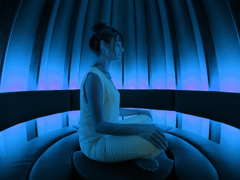 The Open Vessel meditation pod has adjustable lighting and choices of music to help restore focus, balance, and energy.