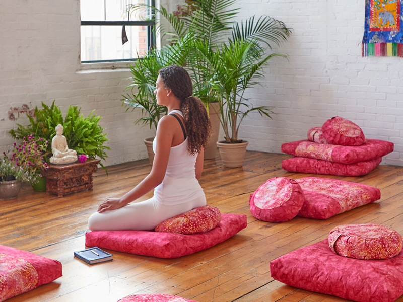 A meditation pillow can help with posture, which in turn helps to keep the mind focused. Photograph: Used with permission of dharmacrafts.com
