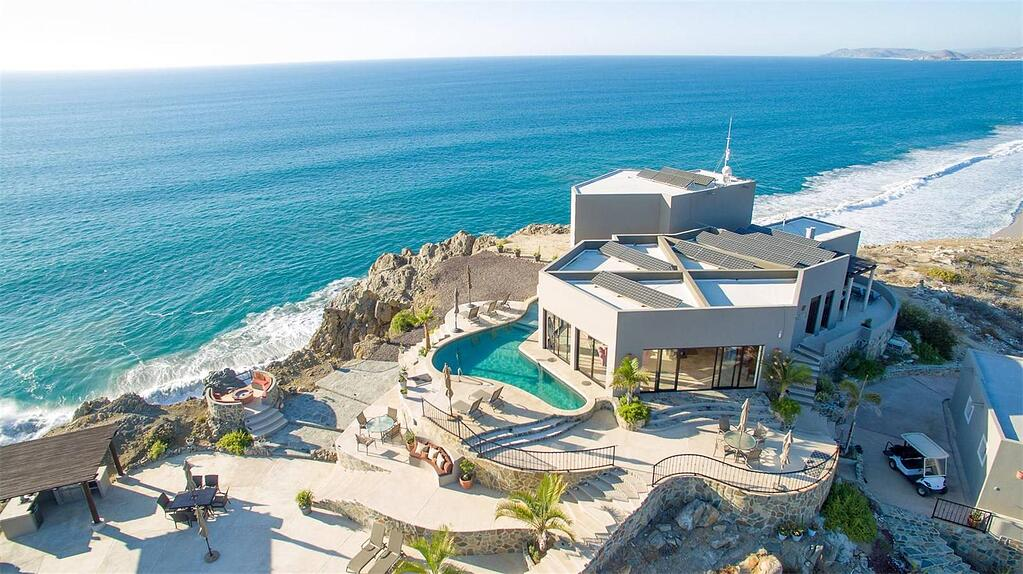 This contemporary oceanfront villa, just outside Cabo San Lucas, was built with locally sourced stone from the Sierra de la Laguna mountains. The home is also 100 percent solar powered.
