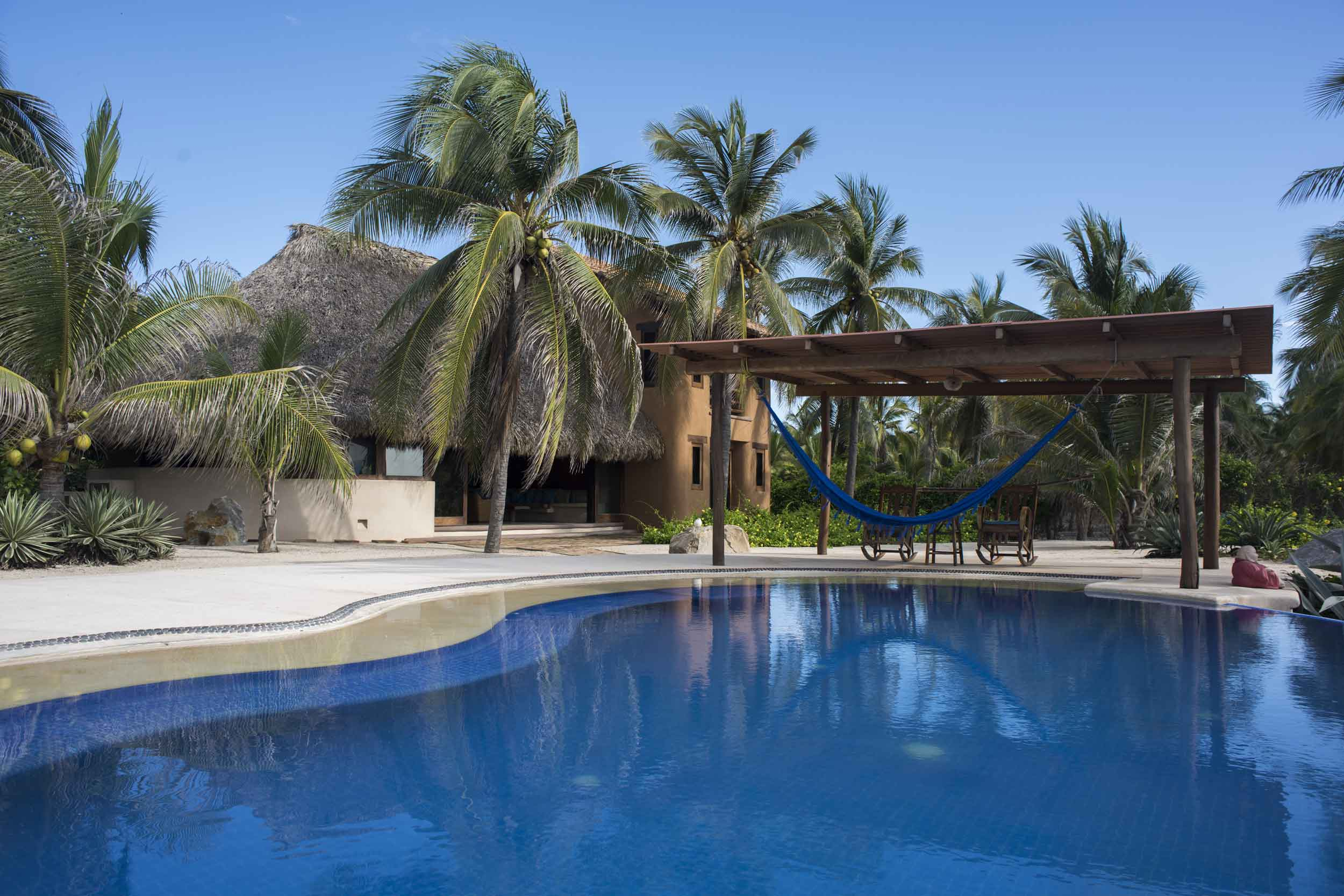 A study in blue: Pool, surf and mountains majesty. Nestle into one of this estate's hammocks and enjoy.