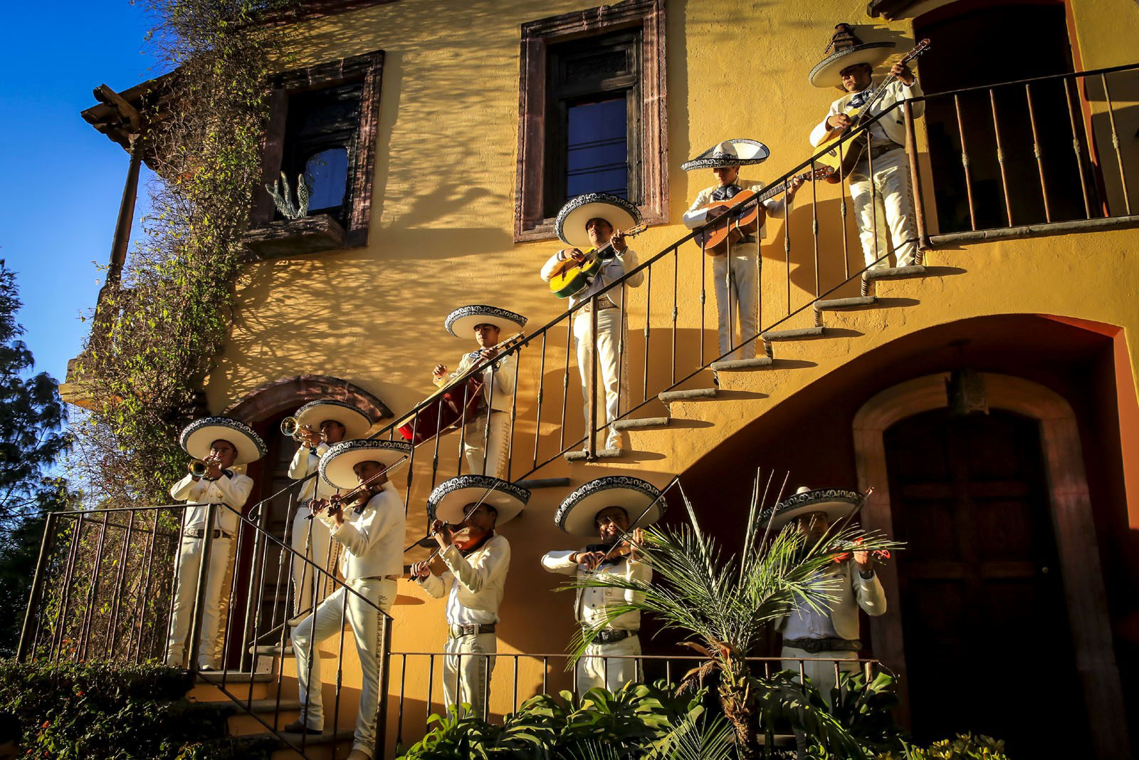 A traditional Mariachi band plays from the staircase at Casa Chorro; the historic compound hosts one to two weddings each month.