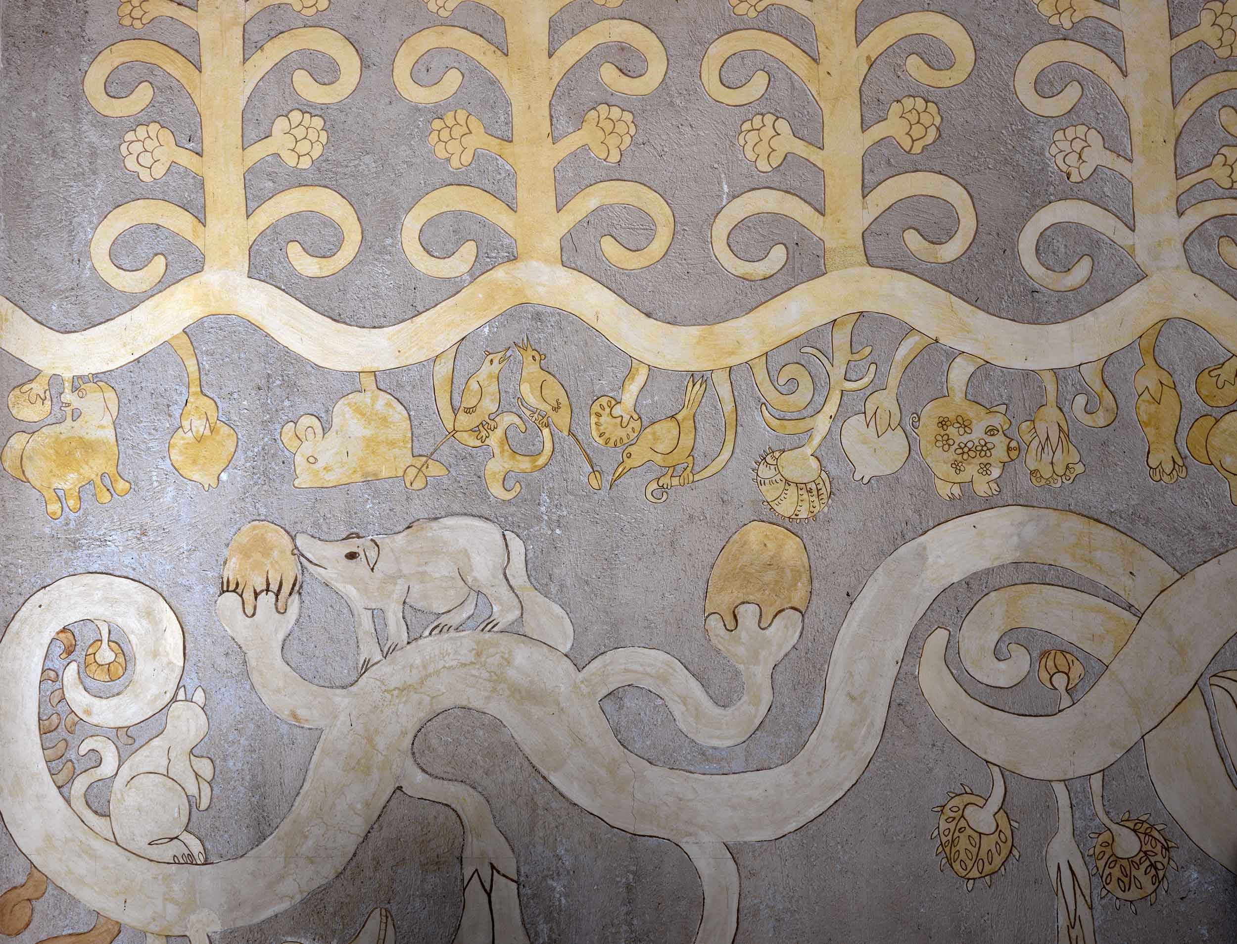 This original 19th-century mural, depicting animal and bird motifs, is just one of the home's many decorative elements.