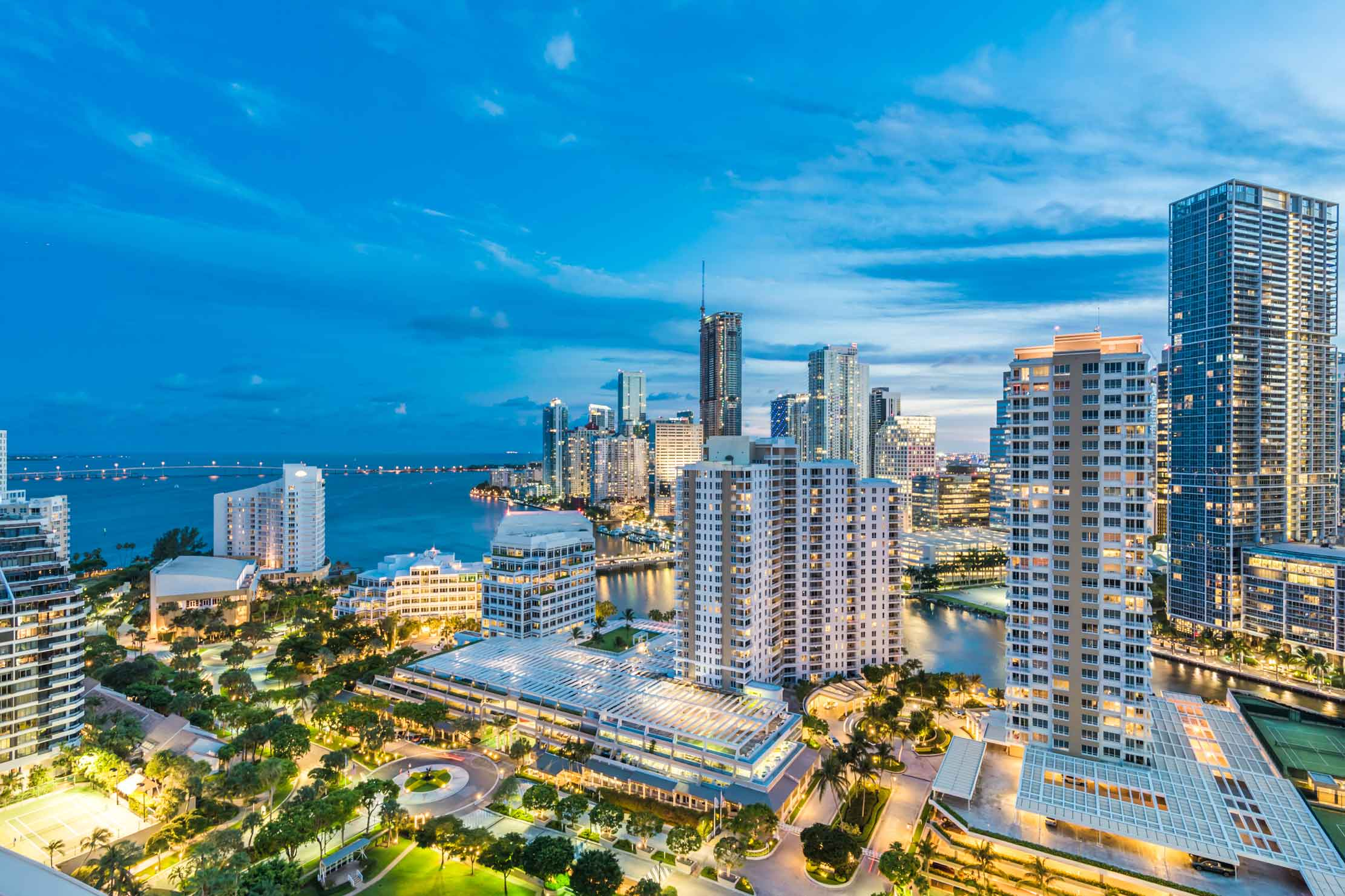 This desiger duplex on the exclusive island of Brickell Key overlooks downtown Miami, Biscayne Bay, and the Atlantic Ocean.