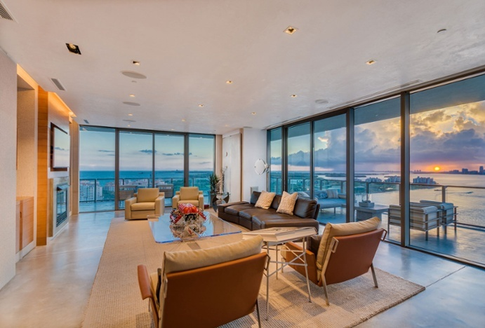 In Miami, Florida, this spectacular high-floor condominium in the Apogee South Beach offers gorgeous views of the Miami skyline and the Atlantic Ocean.