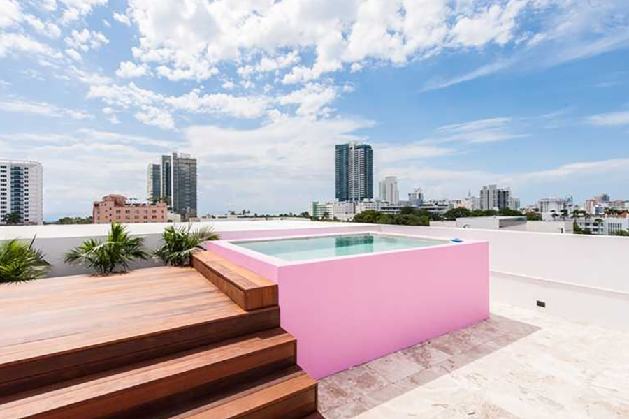 A pink rooftop spa adds a dash of Miami's famous color to this gleaming four-story townhouse.