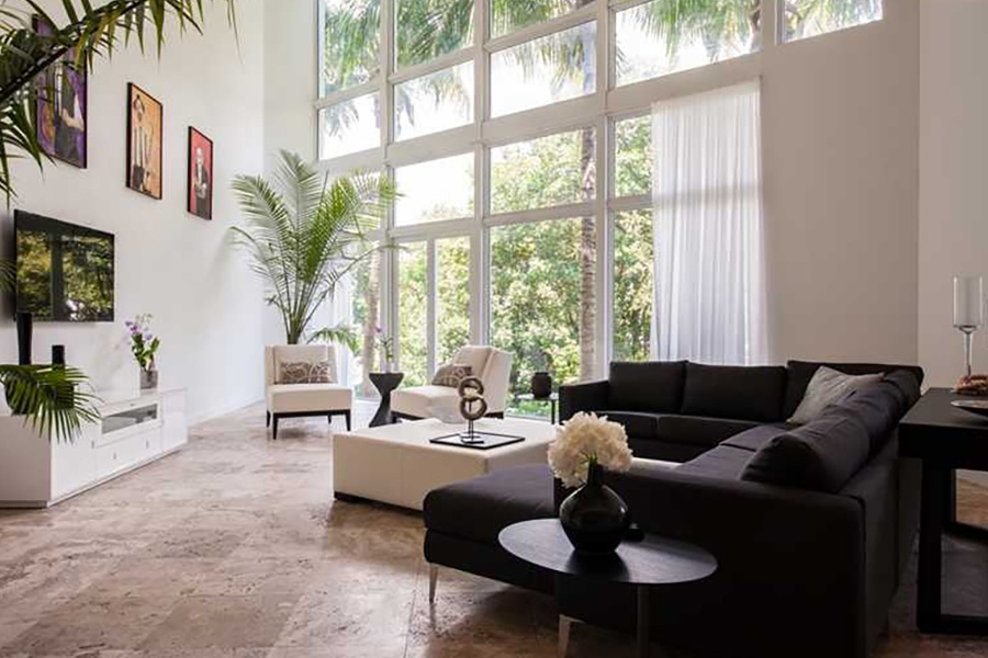 Modern interiors complement the dynamic design of this Miami Beach townhouse by architect Todd Michael Glaser.