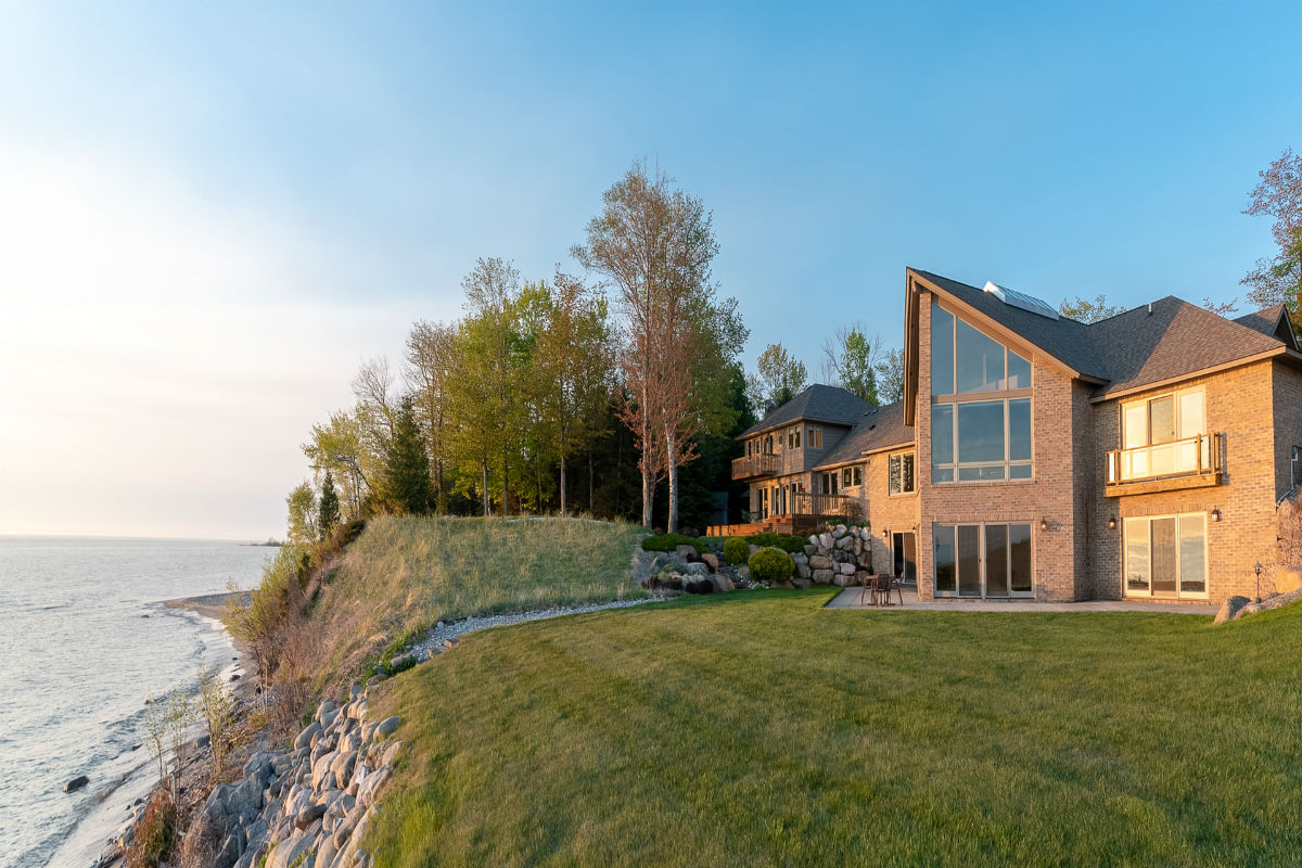 This contemporary home on 19 wooded acres offers relaxing solitude on the shores of one of America's Great Lakes.