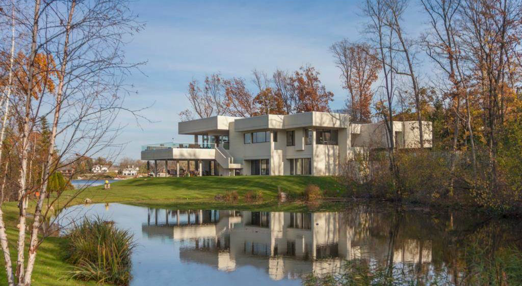 On 2 acres overlooking Lower Long Lake, this 2005 contemporary home has a glass tile-enclosed indoor pool as well as floor-to-ceiling windows with breathtaking views.