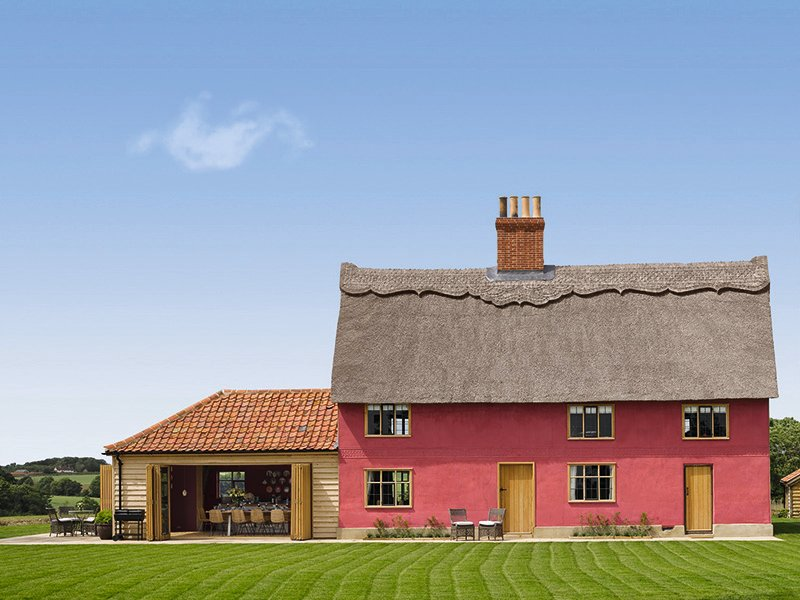A bold pink thatched farmhouse set on the 5,000-acres Wilderness Reserve, Moat Cottage sleeps 12 in double-bedroomed, oak-beamed comfort. Photograph: Will Pryce