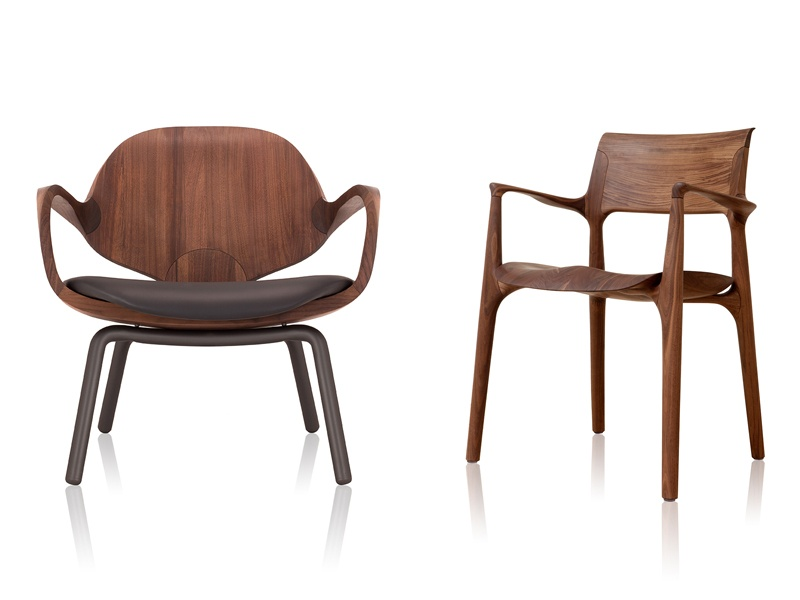 Jader Almeida's CLAD armchair (left) and EASY chair (right), both seen here in a solid walnut finish, embody a mid-century-modern design aesthetic.