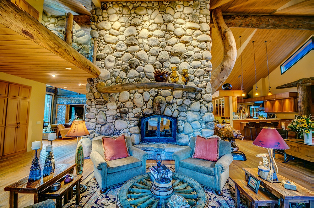 The centerpiece of this custom-designed Montana log home is a massive hearth handcrafted from locally sourced stone and wood.