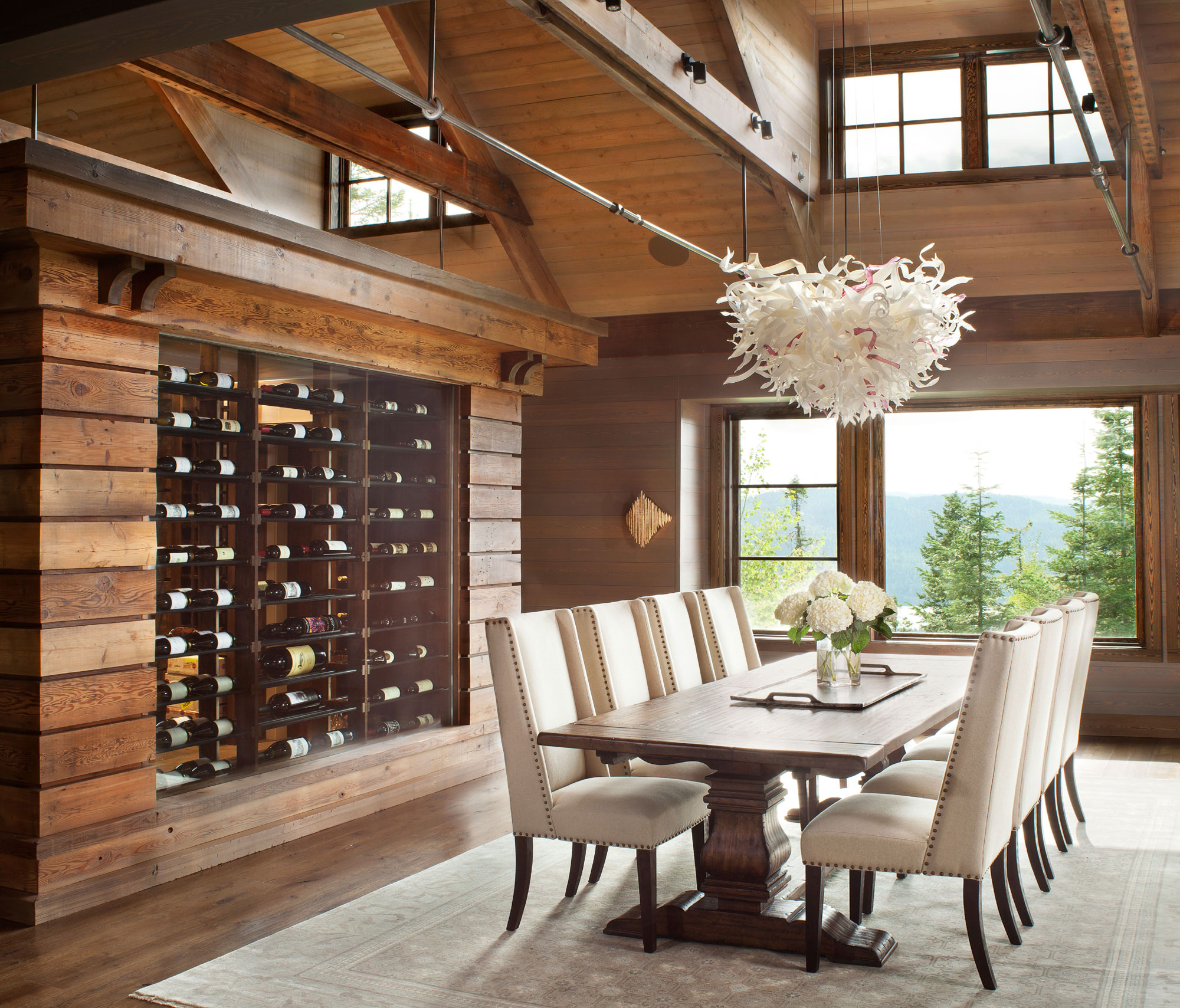 The home's unique wine room doubles as a temperature controlled, multi-bottle storage; glass walls on both sides provide a stylish focal point for both the great room and the dining room.