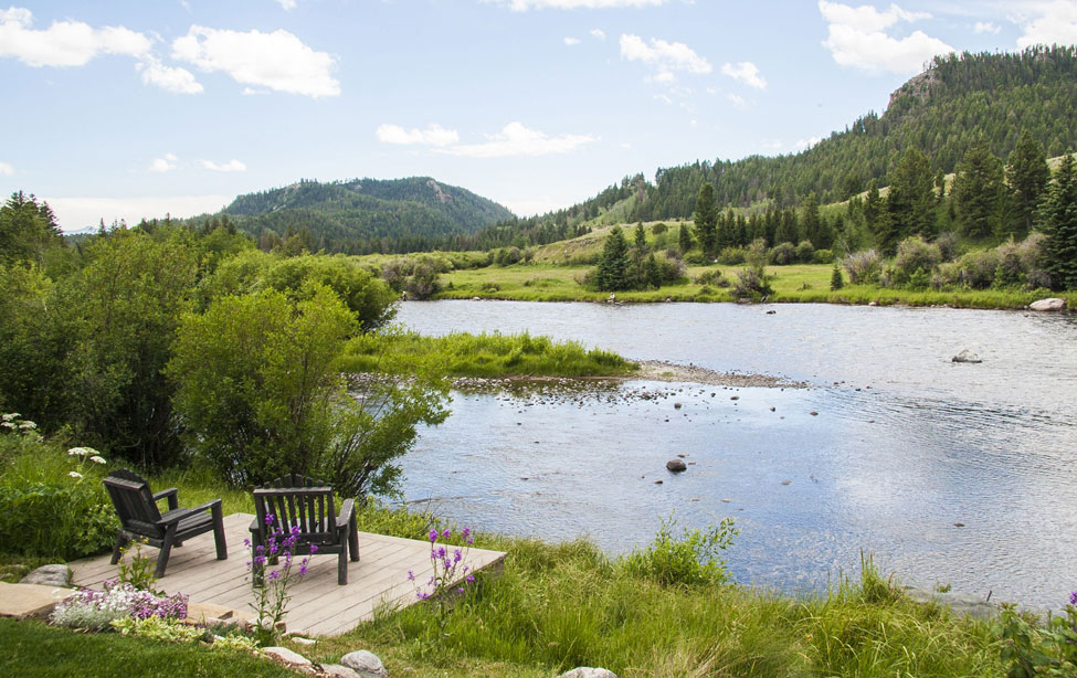 Enjoy views of the Madison River from this four-bedroom lodge home on 4.75 private acres.