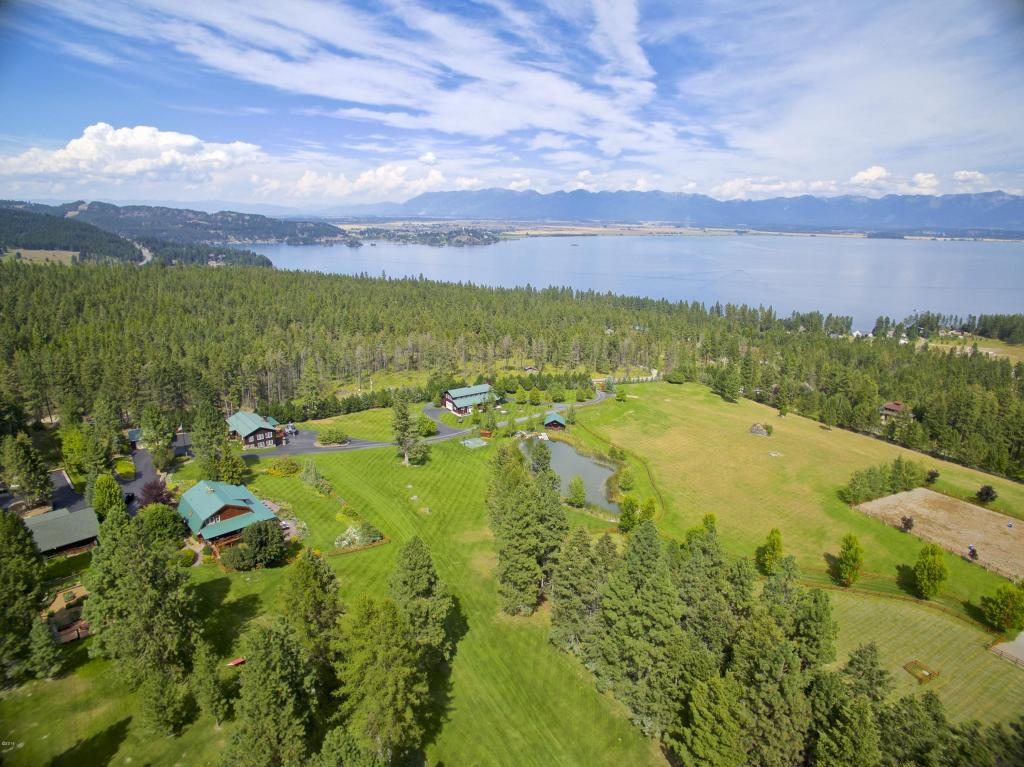 Bordering Glacier National Park, this spectacular 23-acre Montana ranch sits above Flathead Lake with views of Whitefish Mountain.