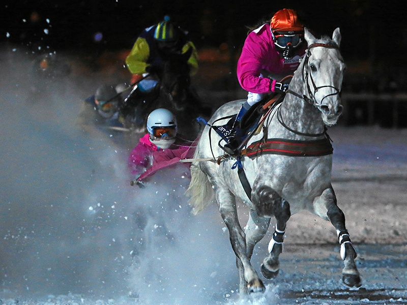 Jockeys can reach speeds of up to 30 miles an hour in White Turf's skikjöring race, and colored skis are compulsory, so that horses can see them in the snow. Photograph: Swiss-image.ch/Andy Mettler