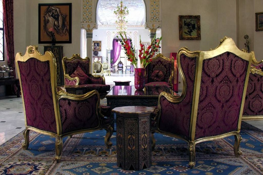 Carved ceilings, splendid chandeliers, and Moorish detailing embellish this gorgeous Moroccan home.
