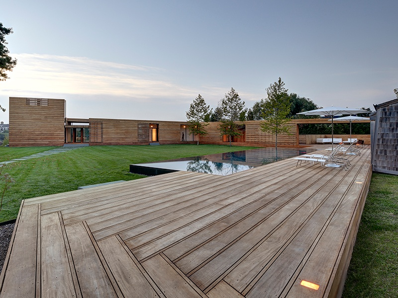 Vacation home Mothersill, in Water Mill, New York, utilizes a boardwalk to weave together a historic site with new building and landscape elements. Photograph: Courtesy of Bates Masi + Architects