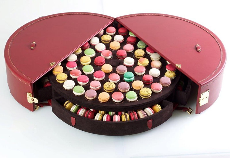 In Moyat's trunk for Pierre Hermé, each delicate macaron can be placed on individual Limoges enamel plates.