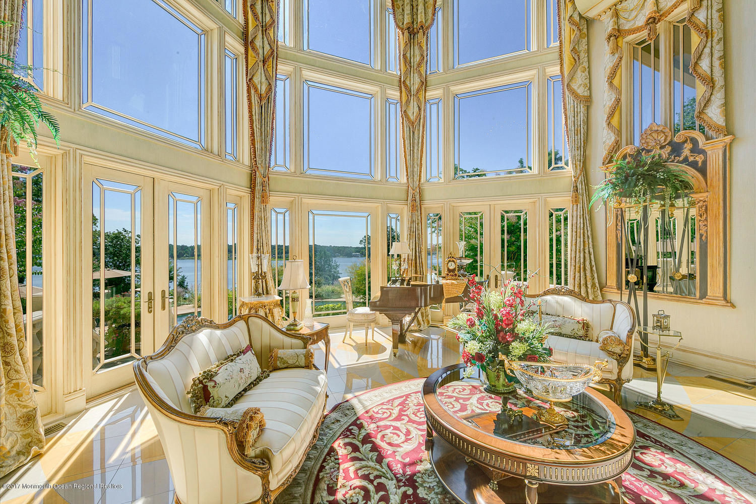 This magnificent château-style manor is surrounded by 4.15 acres of glorious terraced gardens overlooking the Navesink River and the Atlantic Ocean.