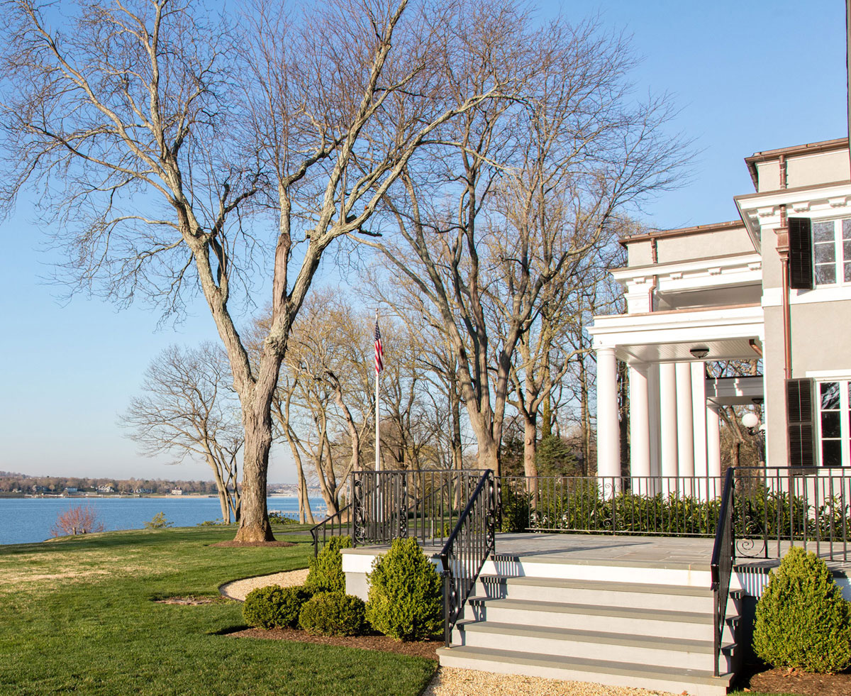 An architectural triumph designed by renowned architect William Welles Bosworth, Riverside is a magnificent 12-acre waterfront estate with equestrian facilities and landscaped gardens fronted by the Navesink River in the peaceful New Jersey Shore community of Red Bank, right next to Middletown and within a 45-minute ferry journey of New York City.