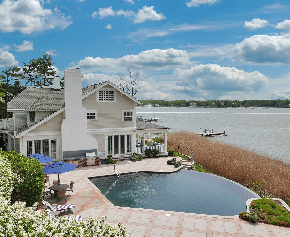 Also in Red Bank, Riverwind is a 17-acre estate on another beautiful stretch of the Navesink River; like the neighboring estates already featured, it too has world-class facilities for recreation both in and out of the water: a private deep-water dock with boat-lift, infinity pool, tennis court, carriage house, and horse barn.