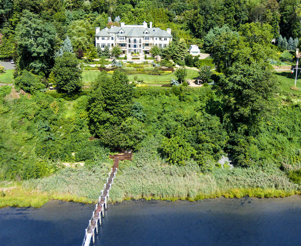 Along with breathtaking views, a boat dock, and terraced gardens, this palatial estate offers a stellar line-up of rare sporting amenities in a lovely waterfront setting on New Jersey's Navesink River.