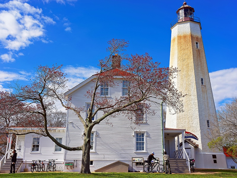 Sandy Hook's picturesque lighthouse and keeper's quarters, which now serves as the visitor center, are 250 and 133 years old respectively. Photograph: Alamy