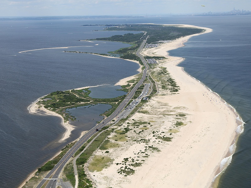 Located on the northern tip of the New Jersey shore, Sandy Hook is a barrier beach peninsula featuring seven miles of ocean beaches, salt and freshwater marshes, and hiking and biking trails. Photograph: Alamy