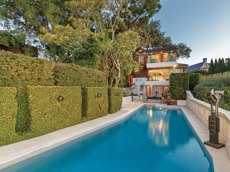 Overlooking Sydney Harbour, this Bellevue Hill home has an expansive north-facing terrace with pool, shaded by mature Chinese elms.