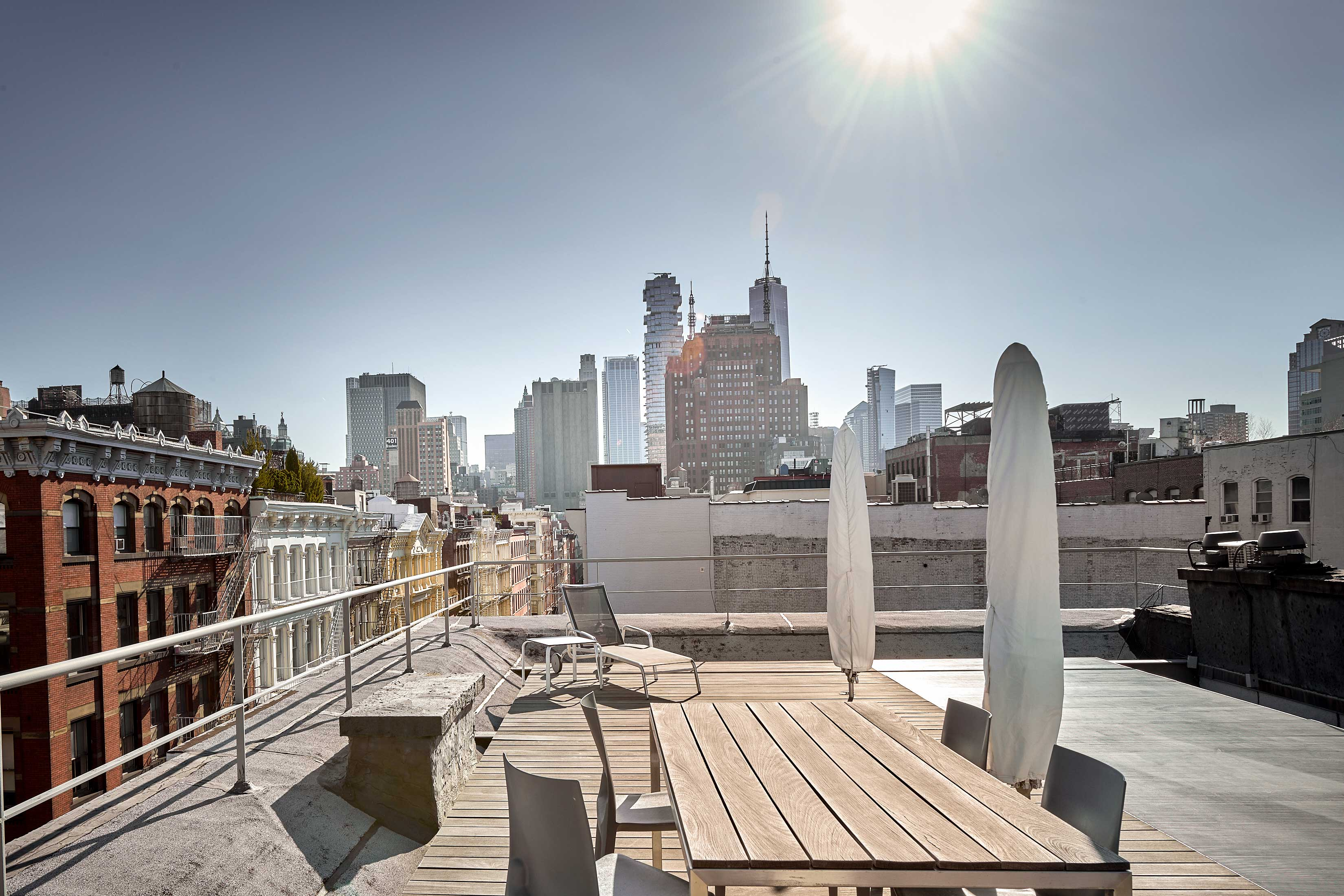 This penthouse loft in the heart of the SoHo-Cast Iron Historic District features a private roof deck with sweeping views of One World Trade Center.