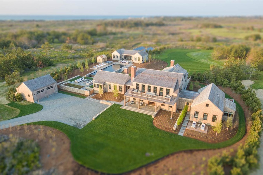 Deftly blending the shingled look of a 19th-century whaling captain's house with a modern interior and technological innovations like geothermal heating, Eel Point is the ideal contemporary Nantucket estate.