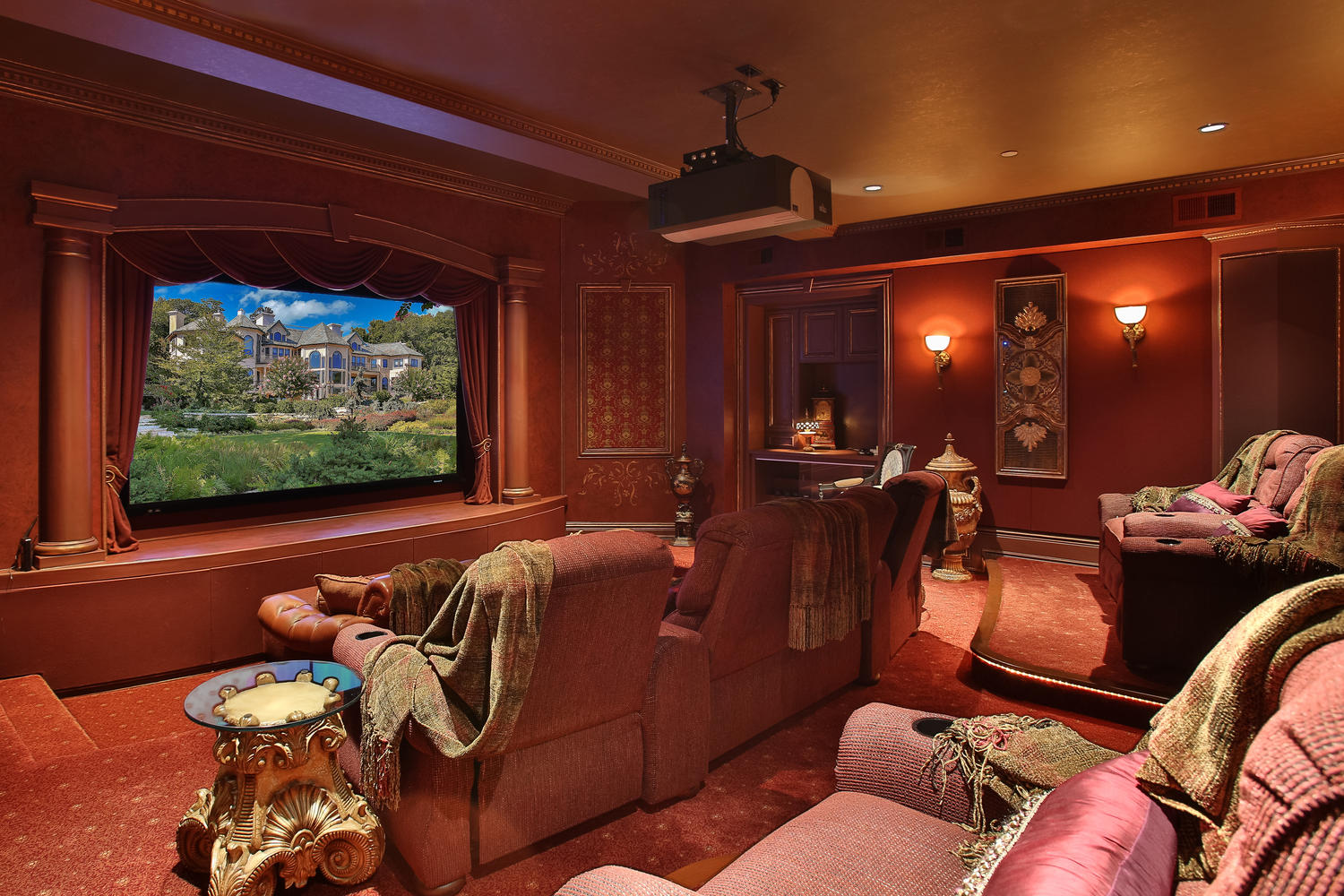 A palatial 20,000-square-foot residence in Middletown, New Jersey, Terraces on the Navesink River impresses with its opulent home theater and adjacent bar and lounge, which provides a luxurious intermission between plays.