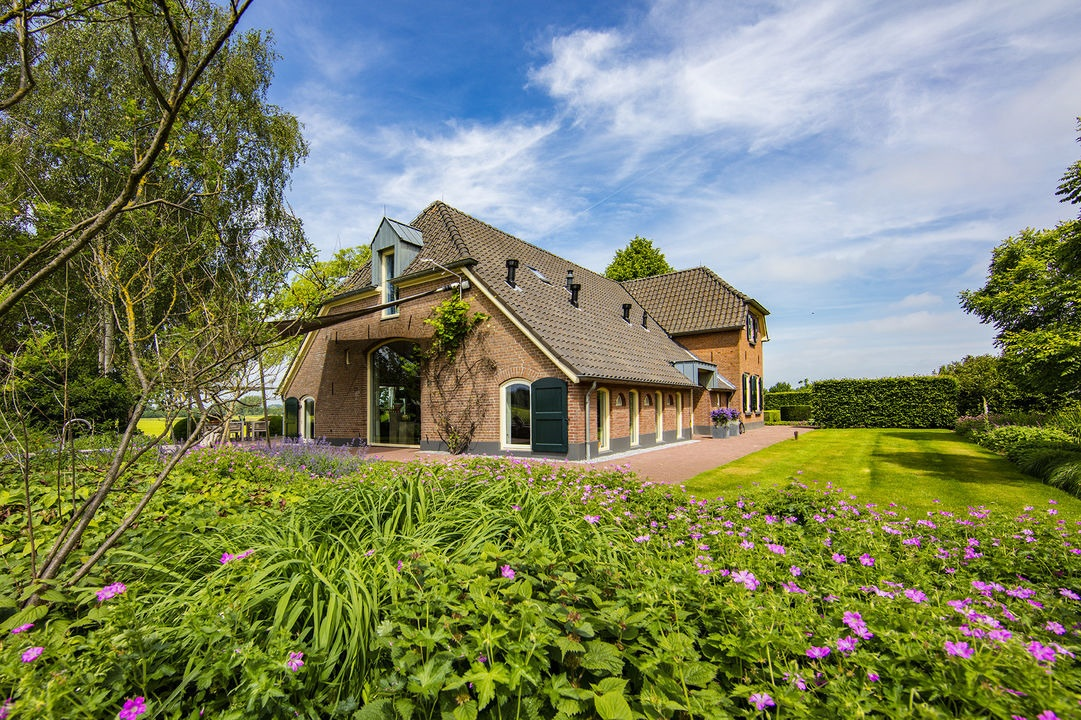 This circa-1870 farmhouse ensconced within the pastoral splendor of Holland's Achterhoek region is a picture of perfection.