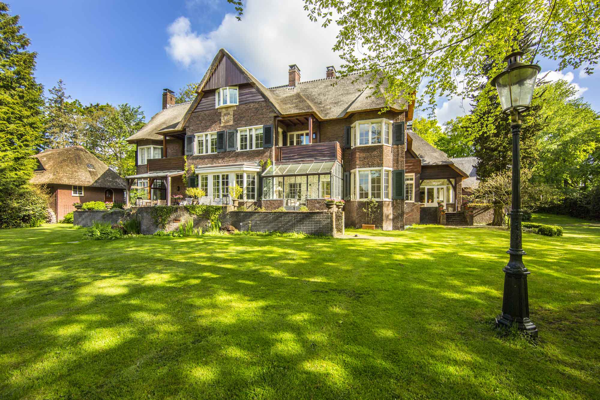 Villa Blauwduin (Blue Dune) is a grand 1920s country estate in the leafy village of Aerdenhout, one of the Netherlands' most coveted areas. There are numerous thatched residents which provide luxurious private copious accommodations extended family or guests.