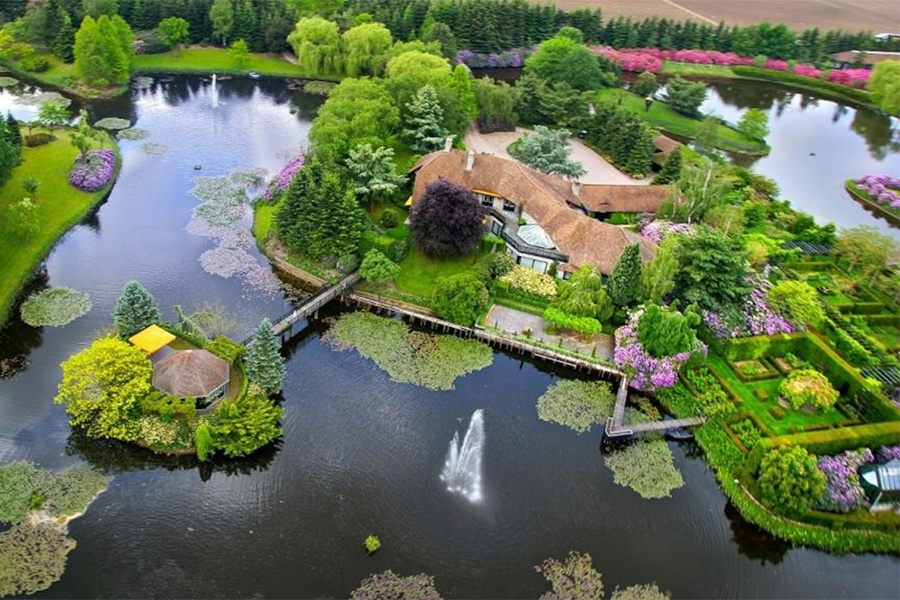 This charming Dutch estate is surrounded by a lake and gardens that give it the feel of an enchanted kingdom.