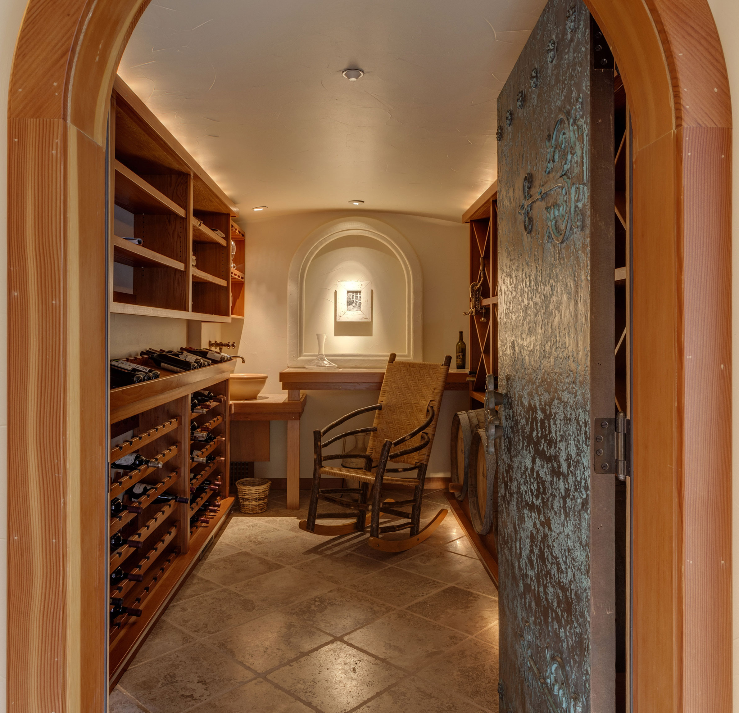 This temperature-regulated wine cellar is a hideaway suitable for leisurely curating and contemplating one's collection.