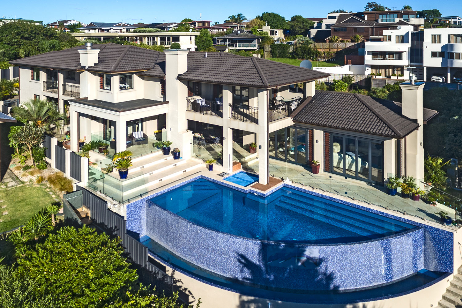 In Auckland, New Zealand, this exceptional Italian-inspired villa commands a hillside location in Bucklands Beach, with sensational views of Rangitoto Island and the channel.