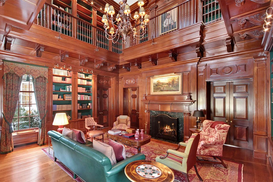 This impressive library with marble fireplace and book-lined gallery provides a true gentleman's or lady's retreat.