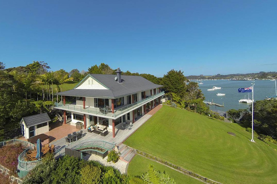 Two residences in one, this unusual waterfront property offers tranquility and beauty and is just a 45-minute flight from Auckland.