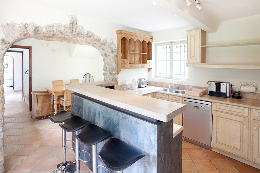While the kitchen retains rustic details like the lovely stone archway that leads to the living room, it has been fully updated with state-of-the-art appliances.
