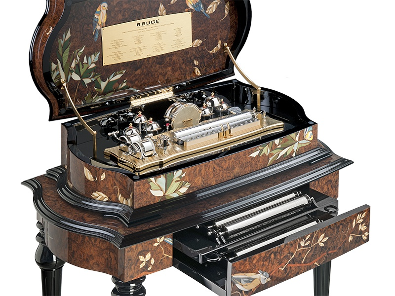 A limited edition of just 12, Reuge's Olbia music box – decorated with birds and insects in 3,849 individual inlaid wood and mother-of-pearl pieces – features eight cylinders, bells, and drums.