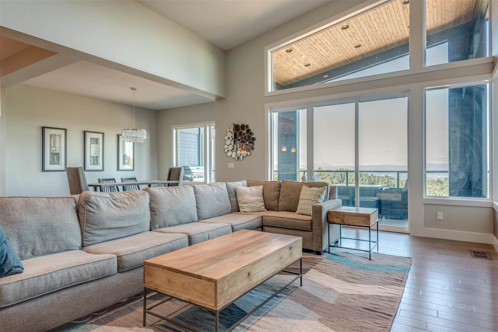 Incredible views of downtown Portland, Mt. Adams, Mt. Rainier, Mt. St. Helens, and Mt Hood can be seen from this newly built 4,210-square-foot home in the city's West Hills, a scenic area which links to the city's extensive network of bike trails.