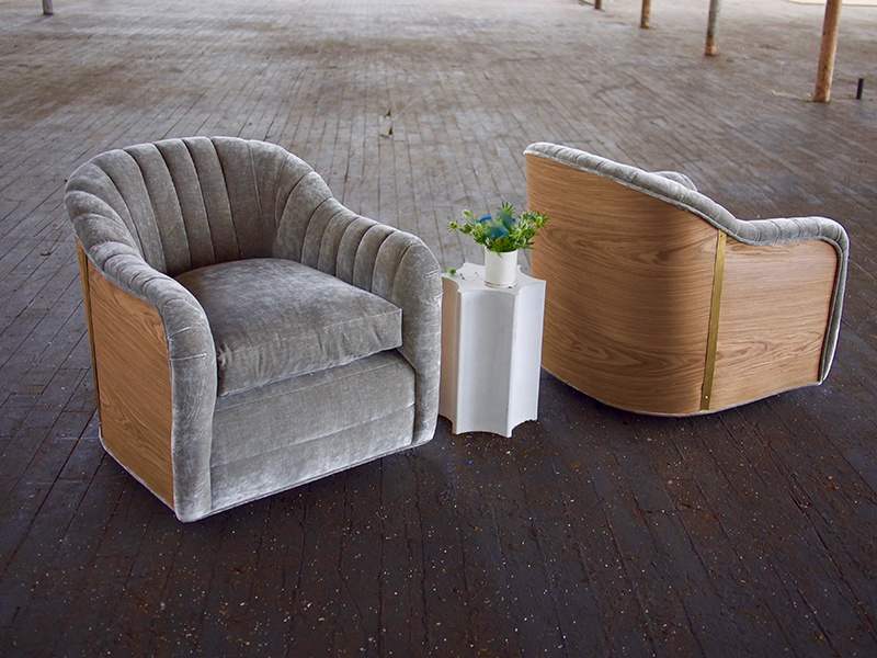 Elizabeth Ingram's furniture line includes the Fabiola Swivel Chair in walnut and brass, and the concrete Stelletta Pedestal.