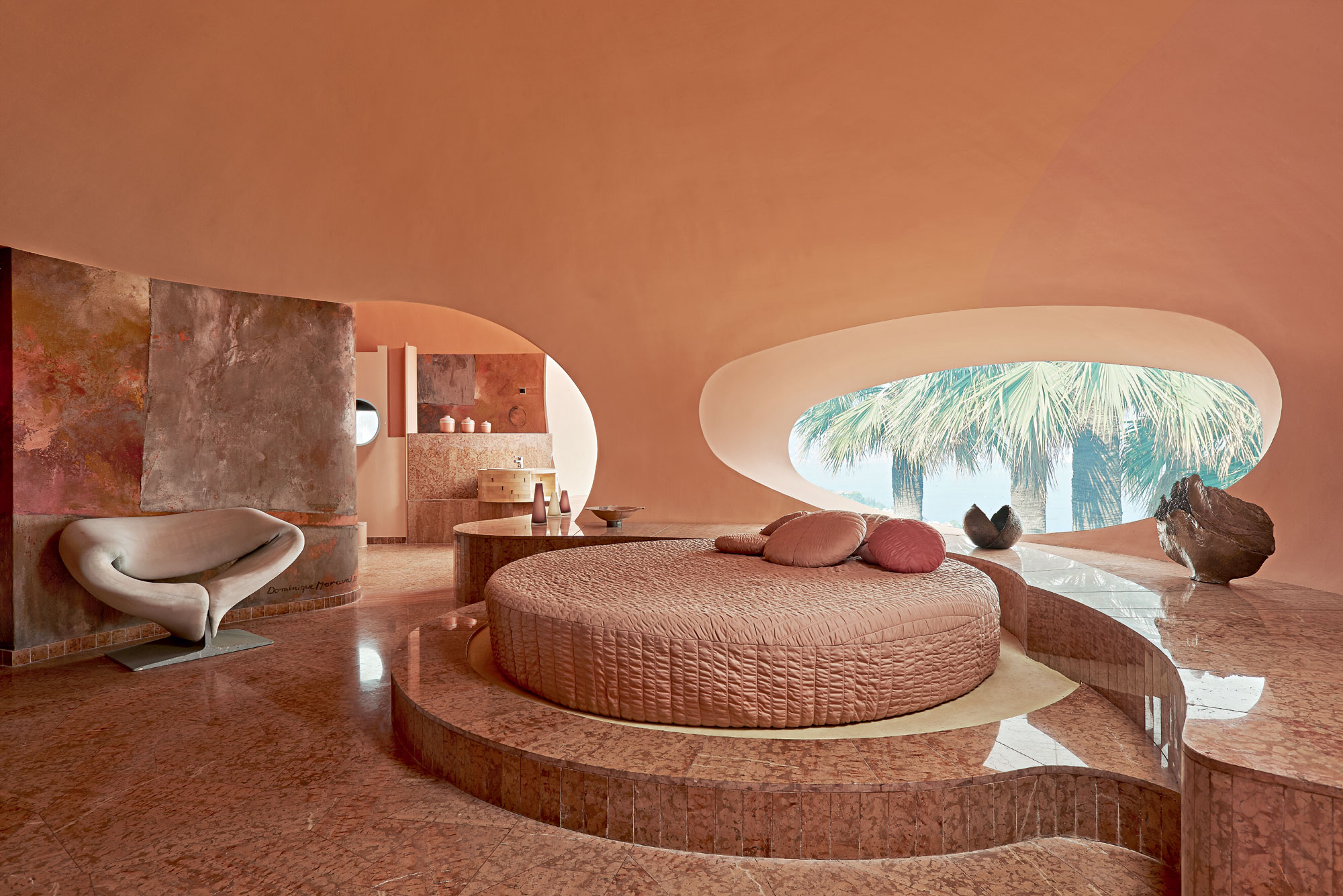The interiors of Palais Bulles are adorned with custom-made furnishings and accessories—designed by Antti Lovag or Pierre Cardin—that echo the curved form of the rooms.