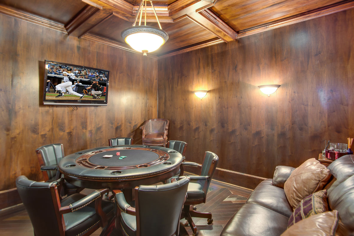 Enhancing the life of luxury in this bayfront home in Sarasota, Florida, are the wine cellar, poker room, bay-view gym and play room, plus garages for 10 cars.